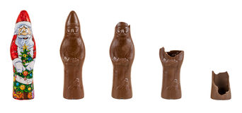 Chocolate figure of santa Claus being eaten. Chocolate figure of santa Claus is being eaten (5 steps isolated over white background with clipping path Stock Photography