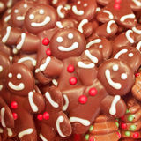 Chocolate figures closeup. Festive background Stock Photography