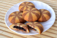 Chocolate filled cookies. Cookies with chocolate filling on a plate over bamboo mat stock photo