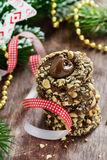 Chocolate filled cookies with hazelnuts, festive decorations. Selective focus Stock Photo