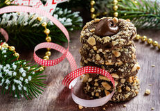 Chocolate filled cookies with hazelnuts, festive decorations Royalty Free Stock Image