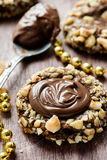 Chocolate filled cookies with hazelnuts, festive decorations Stock Photography