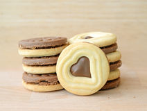 Chocolate filled cookies in heart shape on wooden plate Stock Photo