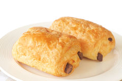 Chocolate filled croissants. On white plate Stock Photos