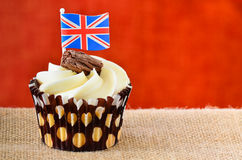Chocolate flake cupcake with Union jack flag. A chocolate cupcake with fondant icing and a chocolate flake with a Union jack flag Stock Photos