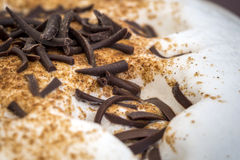 Chocolate flakes on the coffee foam Royalty Free Stock Image