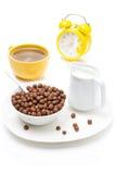 Chocolate flakes, coffee with milk, jug of milk and alarm clock Stock Photo