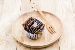 Chocolate flaky mini bread in the wooden plate. Stock Photo