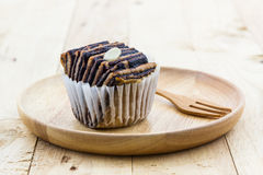 Chocolate flaky mini bread in the wooden plate. Royalty Free Stock Photos