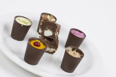 Chocolate with flavors. Flavored chocolates on a white plate Royalty Free Stock Image