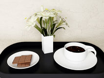 A chocolate, the flowers and coffee Royalty Free Stock Image