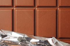 Chocolate with foil Stock Image