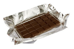 Chocolate on a foil. Dark chocolate on a foil on a white background is isolated Stock Photo