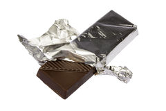 Chocolate on a foil. Dark chocolate on a foil on a white background is isolated clipping path Royalty Free Stock Image