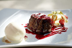 Chocolate fondant. With vanilla ice cream and raspberry sauce stock photography