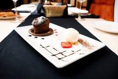 Chocolate fondant. With vanilla ice cream and raspberry sauce royalty free stock photos