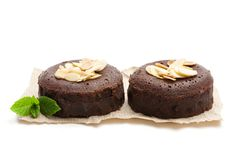 Chocolate fondant with almonds isolated on white royalty free stock photo