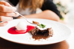 Chocolate fondant. With berry sause and vanilla ice cream royalty free stock images