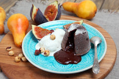 Chocolate fondant. On a blue plate with ice cream and fruits stock images