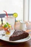 Chocolate fondant cake. With fruit salad and lime juice stock photos