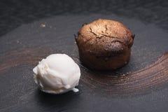 Chocolate fondant cake. With ice cream ball royalty free stock photography
