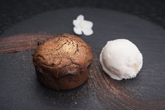 Chocolate fondant cake. With ice cream ball royalty free stock images