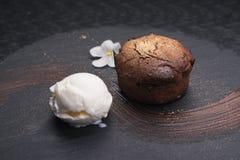 Chocolate fondant cake. With ice cream ball stock image