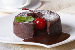 Chocolate fondant with cherries and and coffee. Horizontal Stock Photos