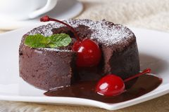 Chocolate fondant with cherries macro and and coffee. horizontal Stock Photography