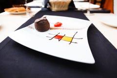 Chocolate fondant. With vanilla ice cream and raspberry sauce stock photography