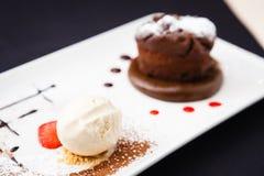 Chocolate fondant. With vanilla ice cream and raspberry sauce royalty free stock photo