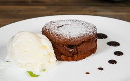 Chocolate fondant. On a wooden background stock photography
