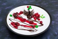 Chocolate fondant with cranberry sauce.  stock photos