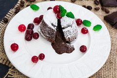 Chocolate fondant with cranberry sauce royalty free stock photo