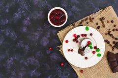 Chocolate fondant with cranberry sauce. Top view. Chocolate fondant with cranberry sauce stock photos