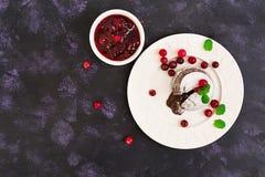 Chocolate fondant with cranberry sauce. Top view. Chocolate fondant with cranberry sauce royalty free stock photos