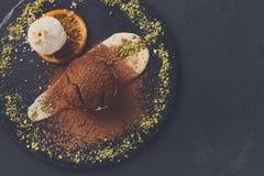 Chocolate fondant with creme anglaise and vanilla ice cream. Exquisite dessert on black background. Chocolate fondant, creme anglaise and vanilla ice cream stock photos
