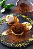 Chocolate fondant with creme anglaise and vanilla ice cream. Exquisite french dessert. Chocolate fondant with creme anglaise and vanilla ice cream, sprinkled stock photography
