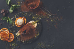 Chocolate fondant with creme anglaise and vanilla ice cream. Exquisite french dessert. Chocolate fondant with creme anglaise and vanilla ice cream on round slate stock photos