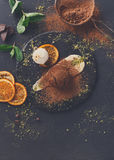 Chocolate fondant with creme anglaise and vanilla ice cream. Exquisite french dessert. Chocolate fondant with creme anglaise and vanilla ice cream on round slate royalty free stock photo