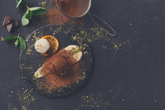 Chocolate fondant with creme anglaise and vanilla ice cream. Exquisite french dessert. Chocolate fondant with creme anglaise and vanilla ice cream on round slate royalty free stock photos
