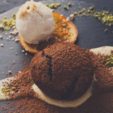 Chocolate fondant with creme anglaise and vanilla ice cream Stock Image