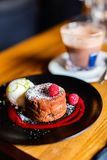 Chocolate fondant. Delicious chocolate fondant dessert served with vanilla ice cream and fresh berries stock images