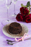Chocolate fondant dessert with roses Royalty Free Stock Image