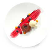 Chocolate fondant with ice cream Stock Images