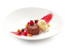 Chocolate fondant with ice cream. And fresh berries stock photos
