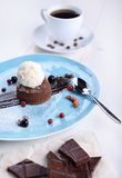 Chocolate fondant with ice cream, pieces of chocolate and coffee. On a white table Royalty Free Stock Image