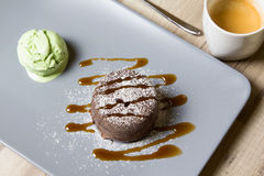 Chocolate fondant lava cake with caramel topping and ice cream. Selective focus royalty free stock photo