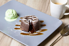 Chocolate fondant lava cake with caramel topping and ice cream. Selective focus stock photos