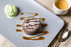 Chocolate fondant lava cake with caramel topping and ice cream. Selective focus royalty free stock photos